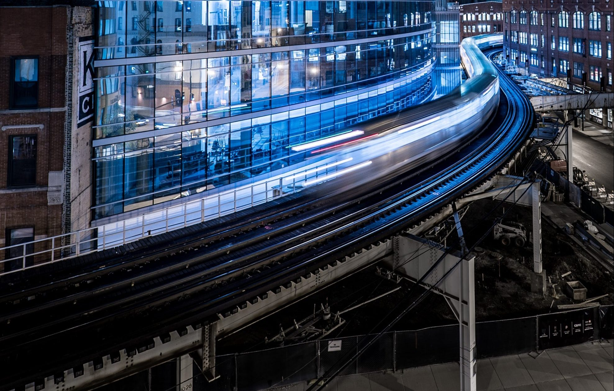 architecture big city building with motion blur train on tracks